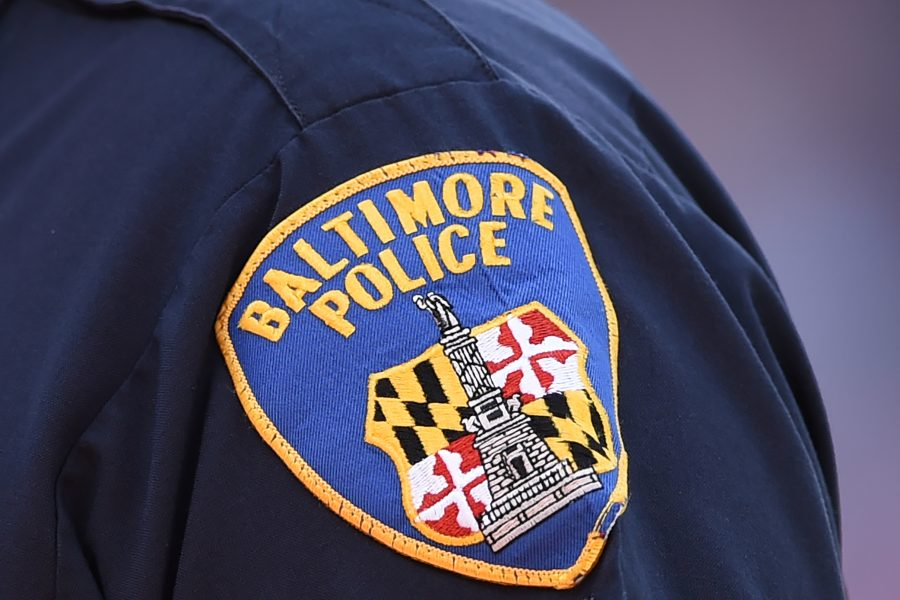 Baltimore Police Investigating After Officer Seen On Video Coughing Near Citizens