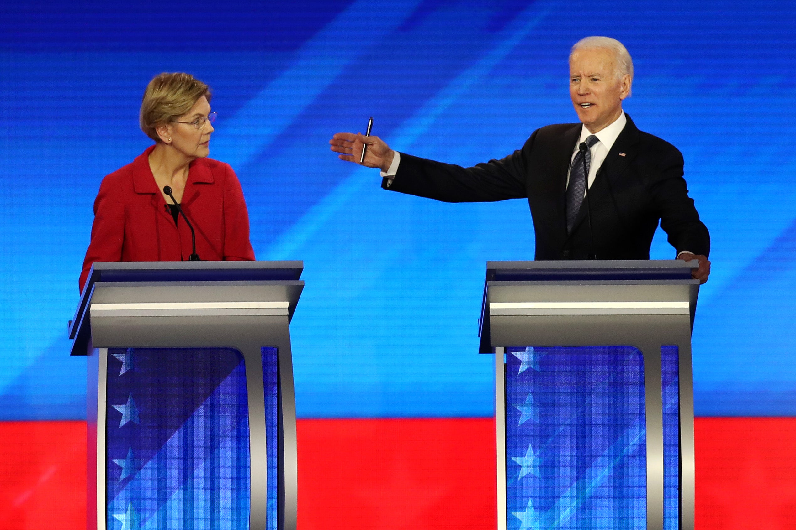 Democratic presidential candidates Sen. Elizabeth Warren (D-MA) and former Vice President Joe Biden participate in the Democratic presidential primary debate in the Sullivan Arena at St. Anselm College on February 07, 2020 in Manchester, New Hampshire