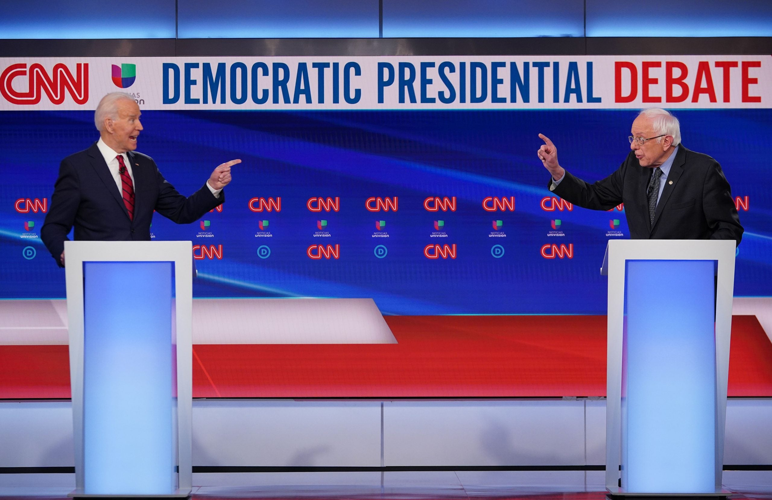 Democratic presidential hopefuls former US vice president Joe Biden (L) and Senator Bernie Sanders (Photo by MANDEL NGAN/AFP via Getty Images)