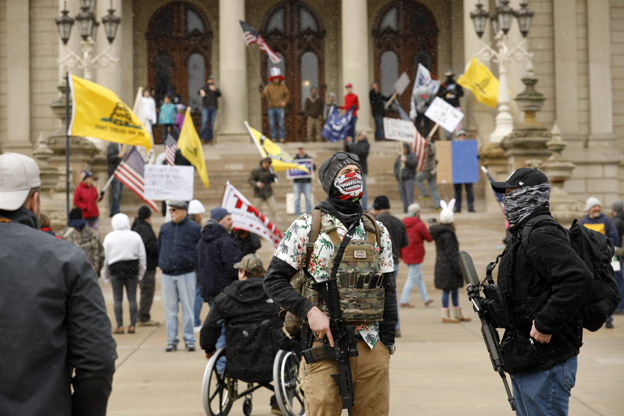 "Protesters during ""Michiganders Against Excessive Quarantine"" at the Michigan State Capitol in Lansing, Michigan on April 15, 2020"