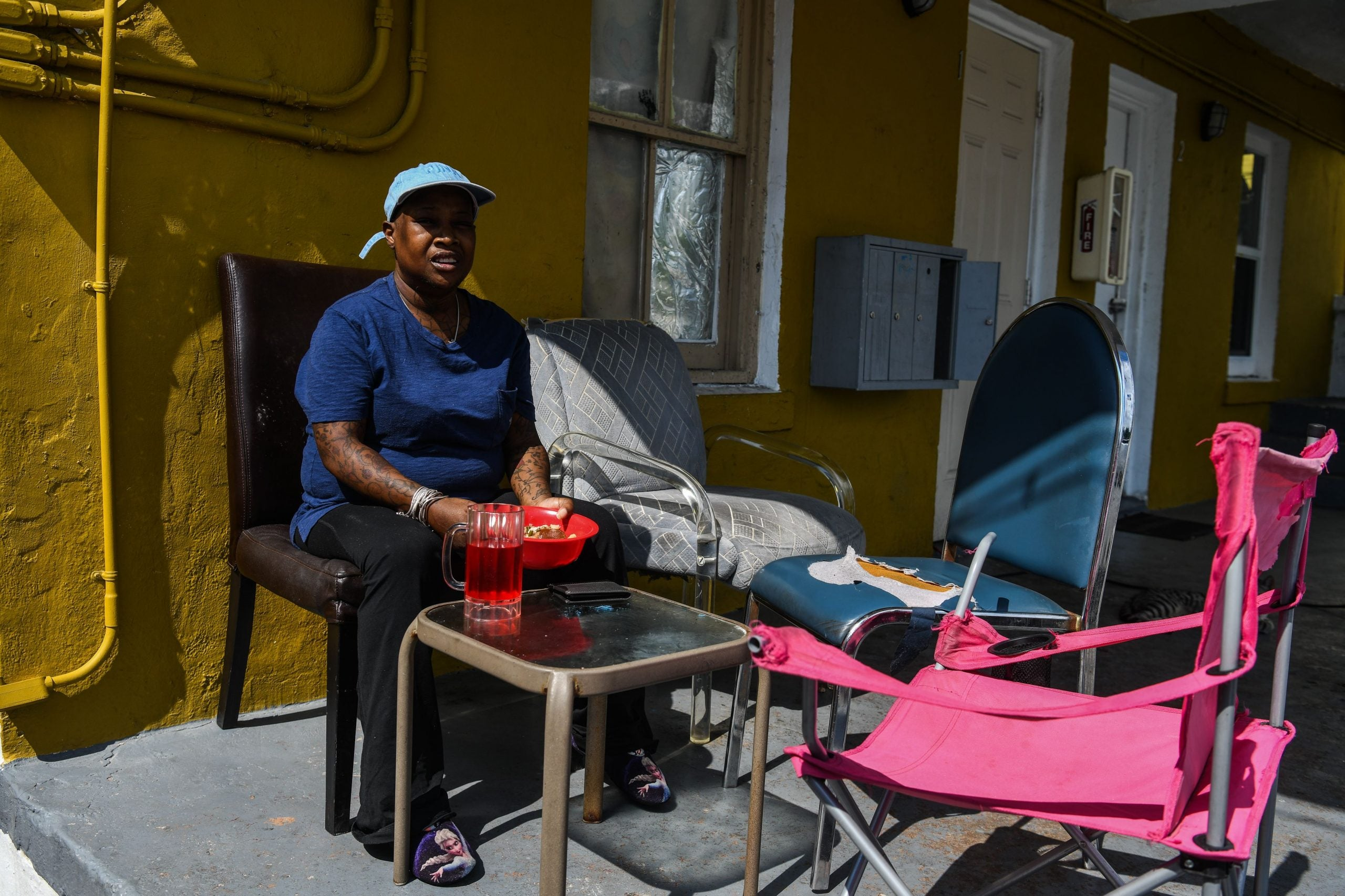 Felicia Jones, 41, eats her food as she sits outside her grandmother's house in a low income, mostly African-American neighbourhood in Miami, on April 19, 2020