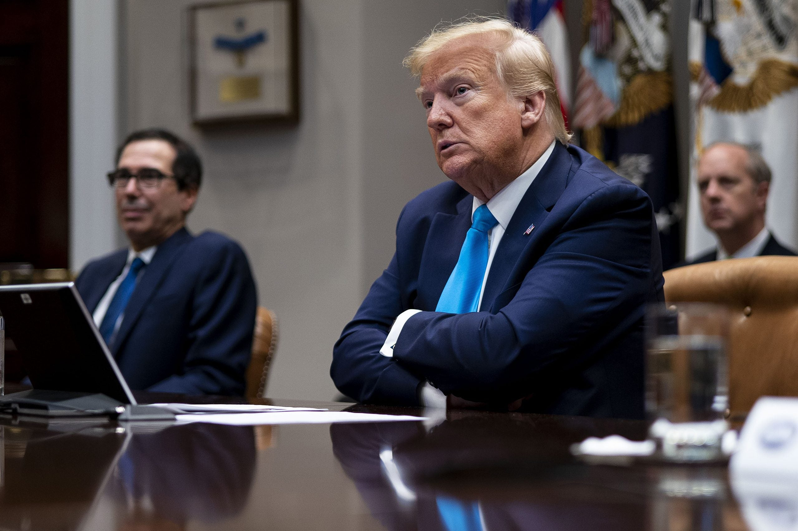 Trump sits with Steve Mnuchin during a video conference about the Paycheck Protection Program