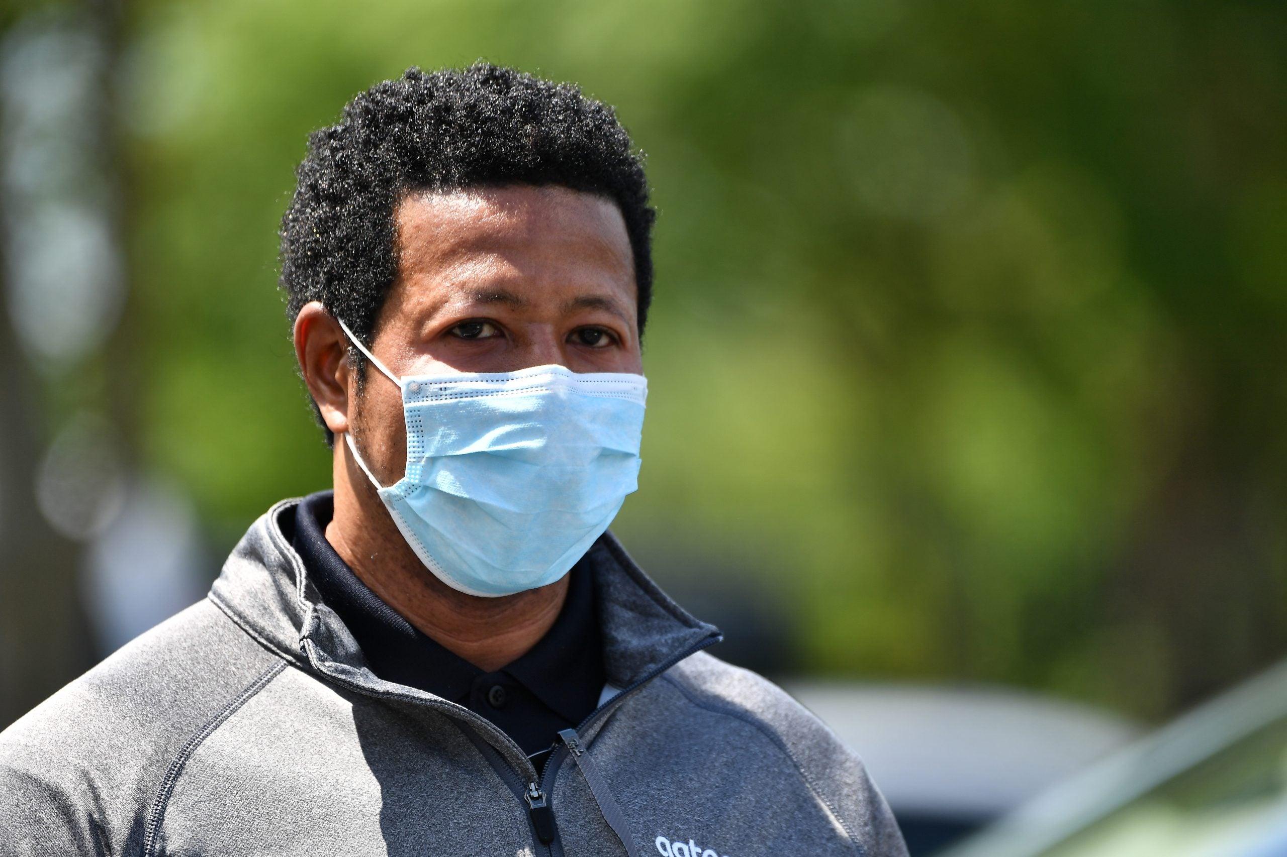 Atlanta resident wears mask before Kemp reverses mask mandate