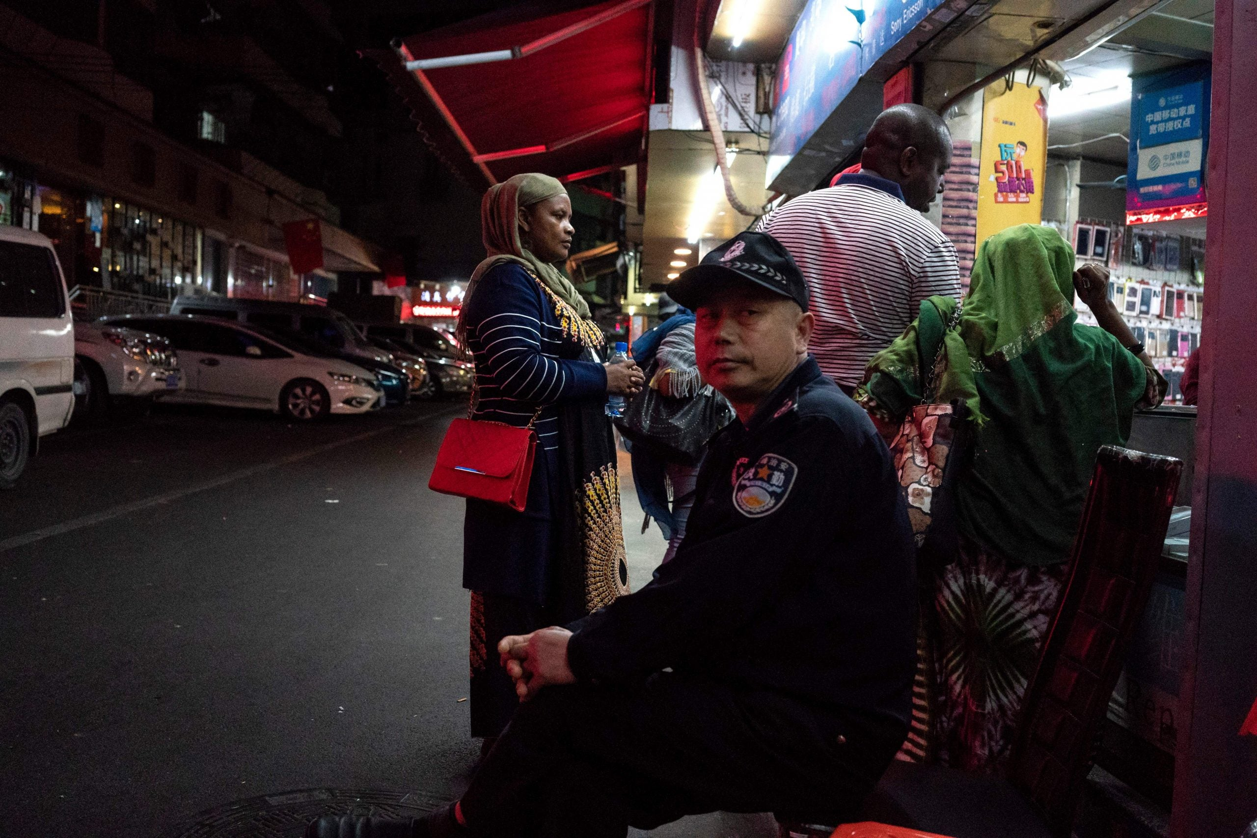 Chinese police officer monitors African patrons in Guangzhou, China