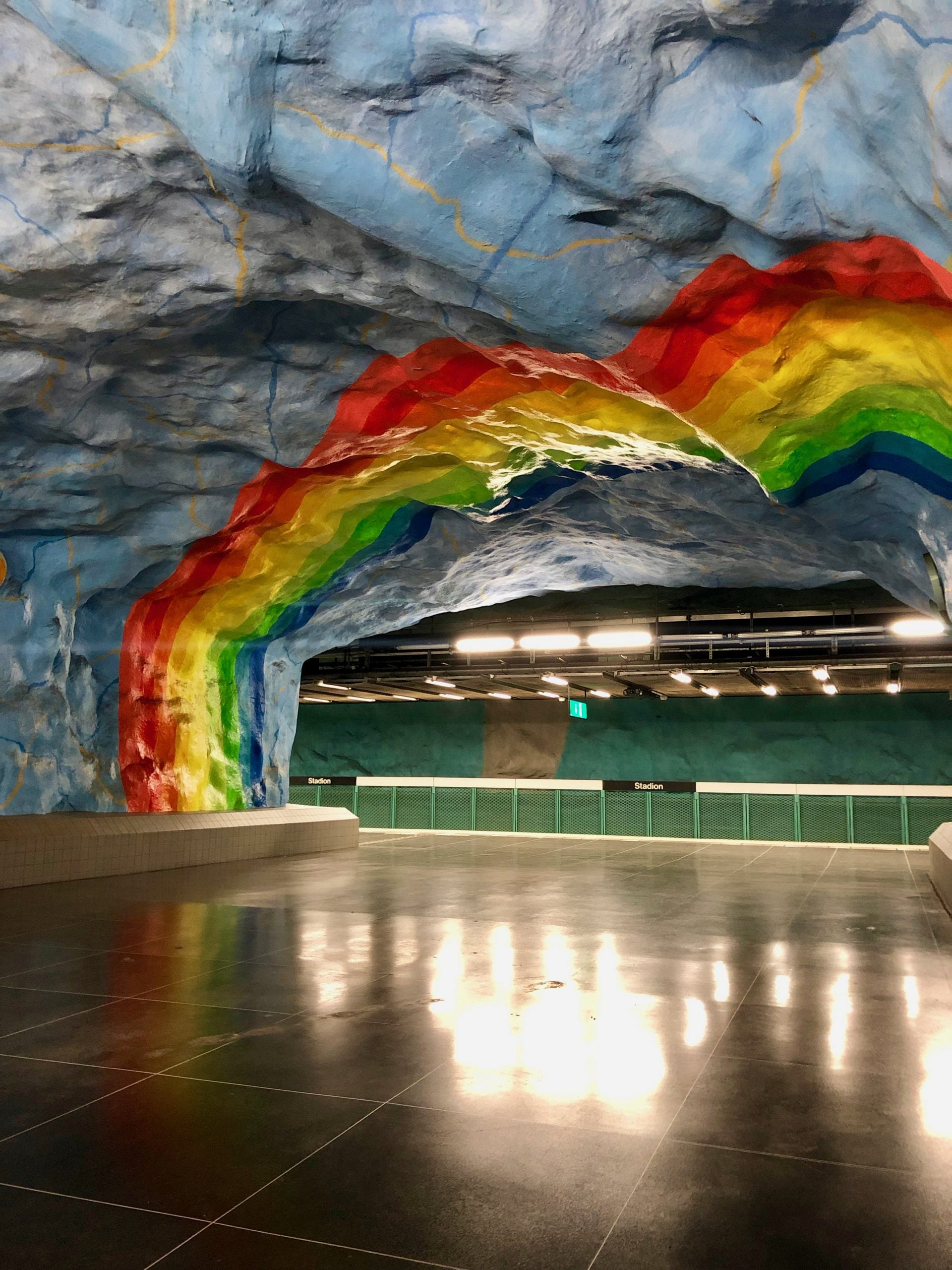 subway in Stockholm covered with art depicting a rainbow