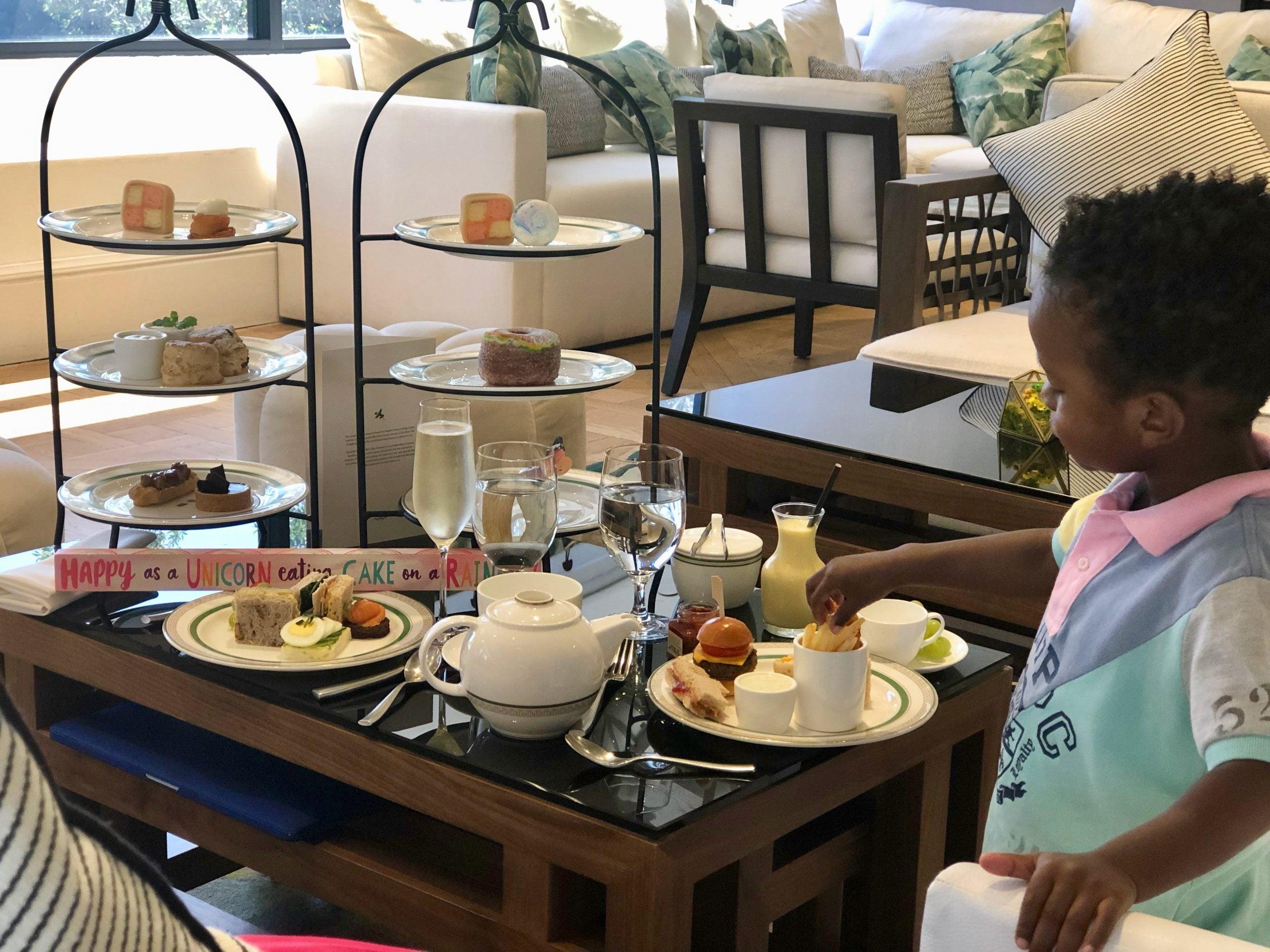 Little boy having tea in SoCal hotel