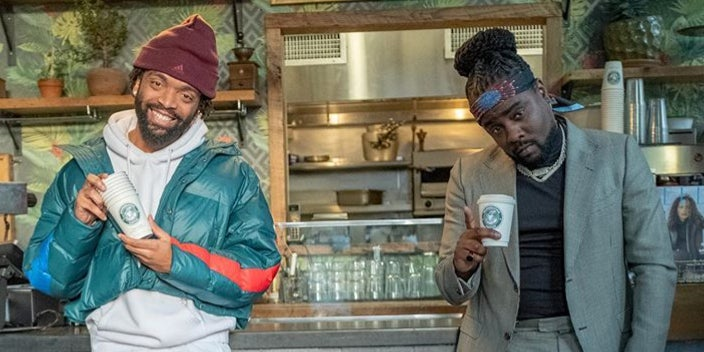 "Kerby Jean-Raymond and Wale pose in front of Morebucks Coffee for the latter's ""Sue Me"" music video."