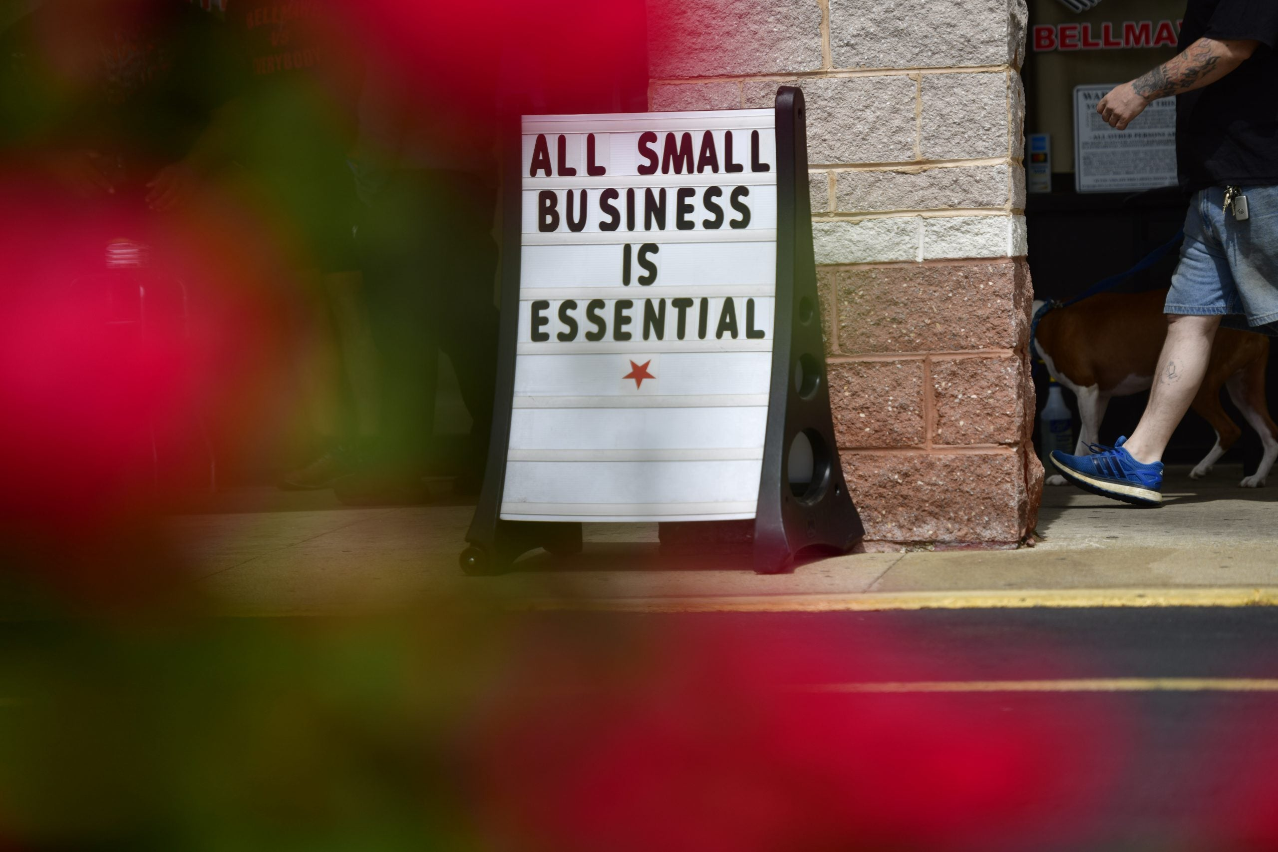 """""""all small business is essential"""" sign displayed on street shows pushback to the rules  implemented in wake of coronavirus outbreak"""
