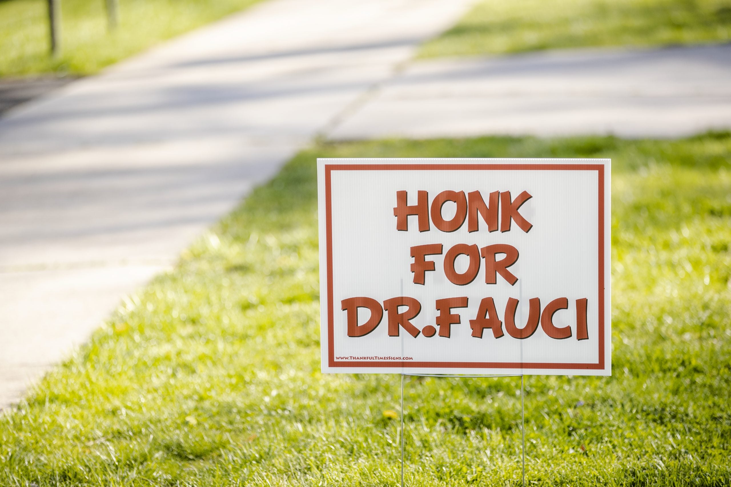 """A sign on a lawn says, """"Honk for Dr. Fauci"""" to show support for Dr. Anthony S. Fauci, M.D., director of the National Institute of Allergy and Infectious Diseases"""