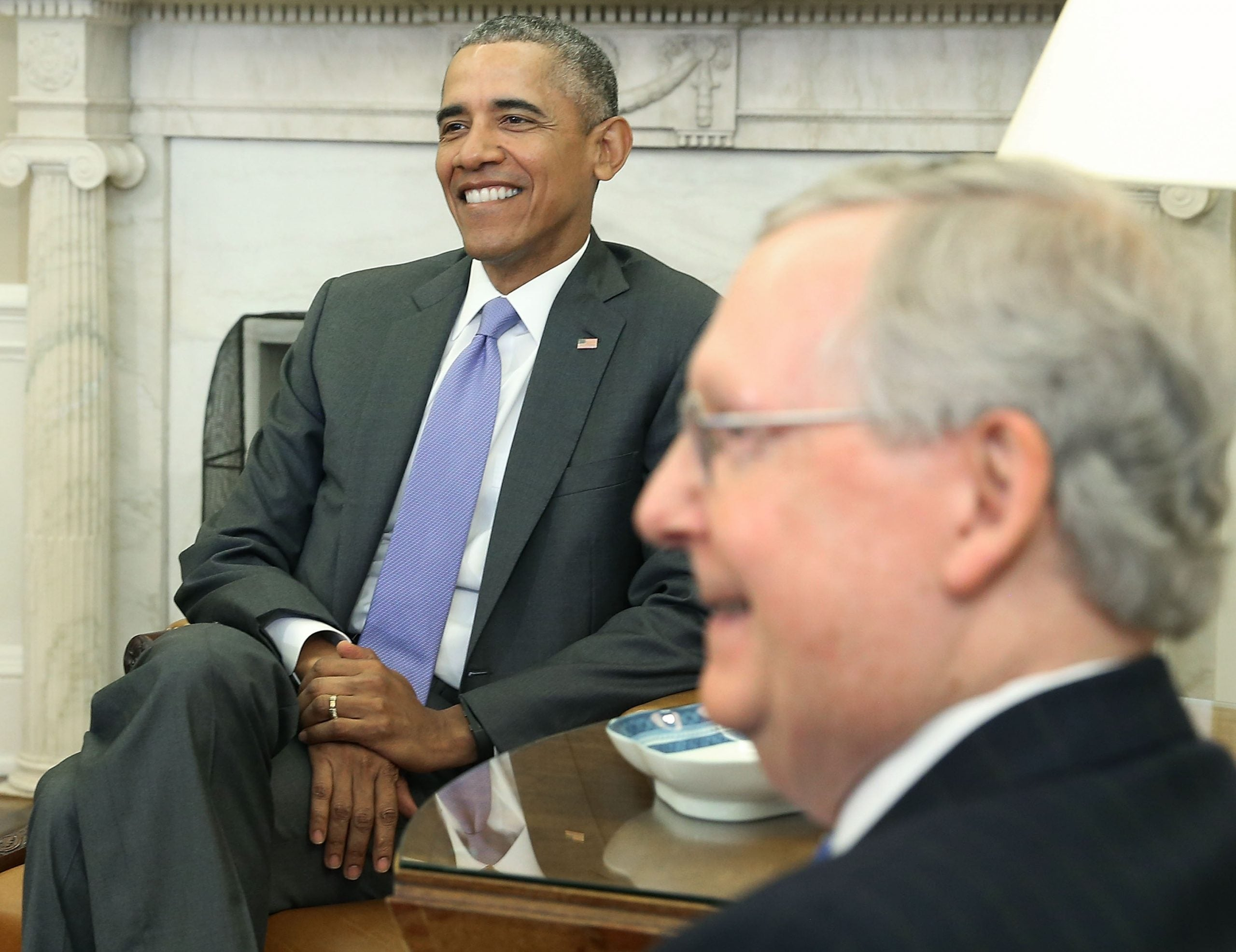 Mitch McConnell and Barack Obama. The Kentucky lawmaker admits he was wrong about the former president.
