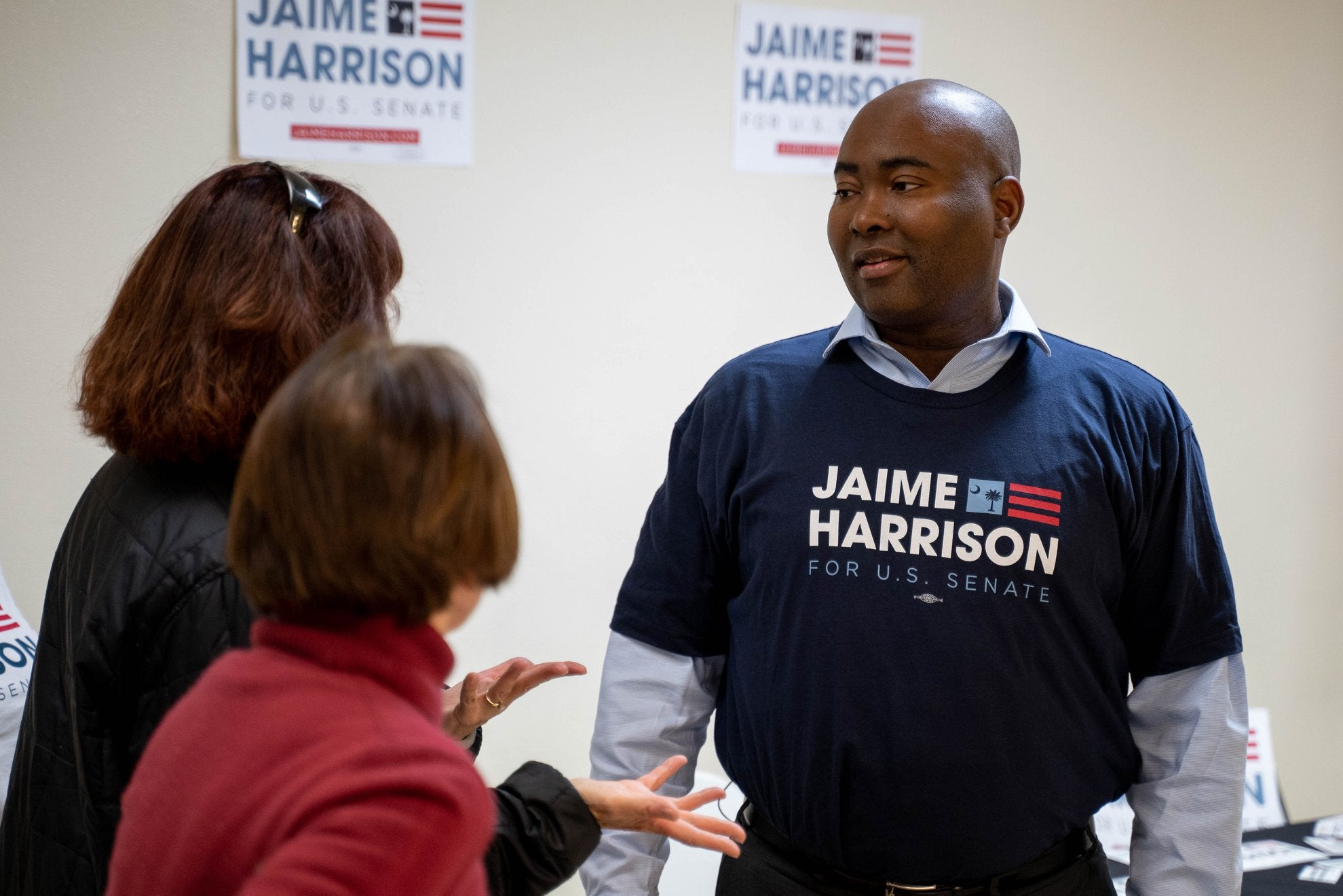 Jaime Harrison wears an election t-shirt with his name