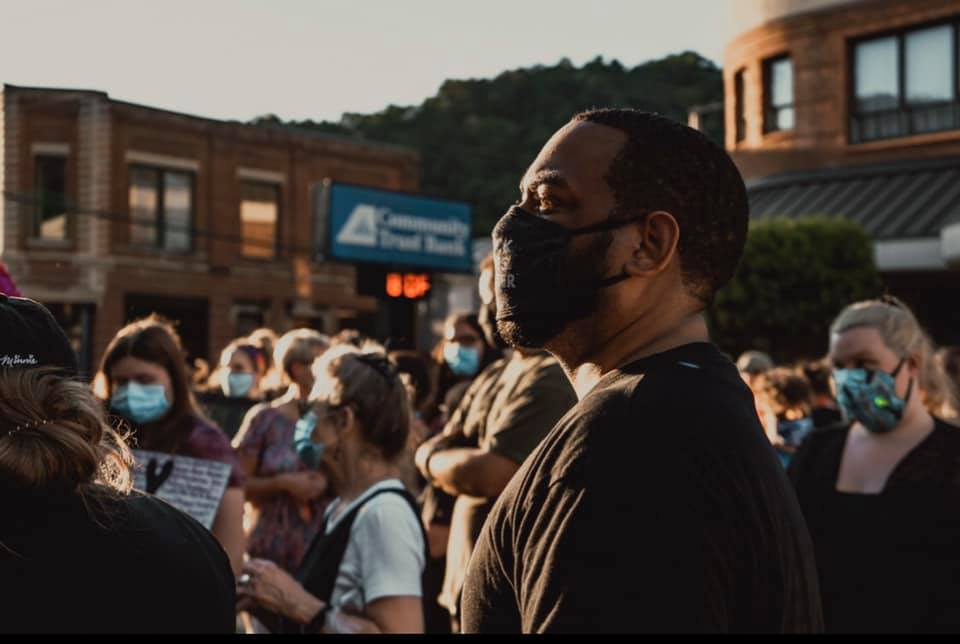 Charles Booker stands with protesters