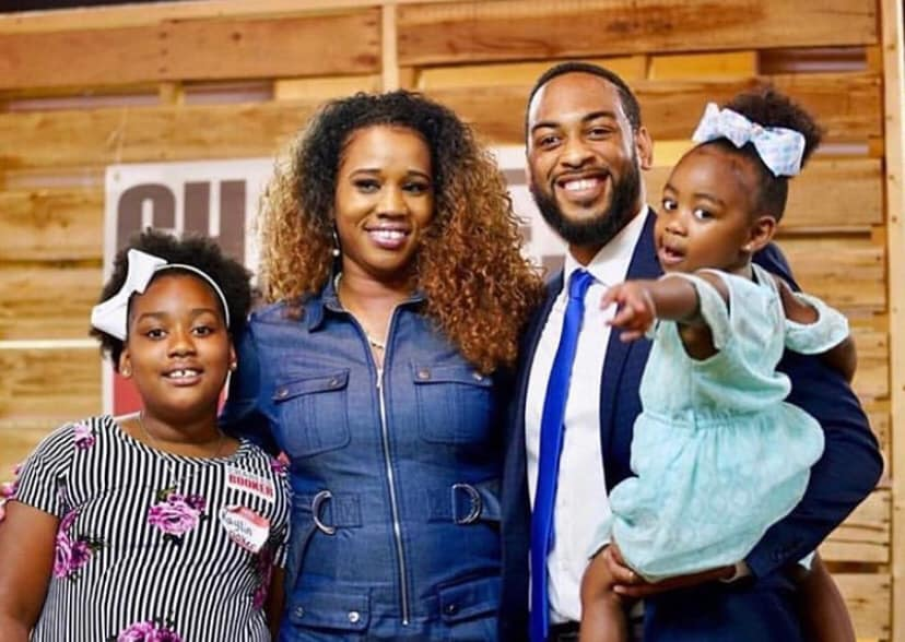 Charles Booker poses with family