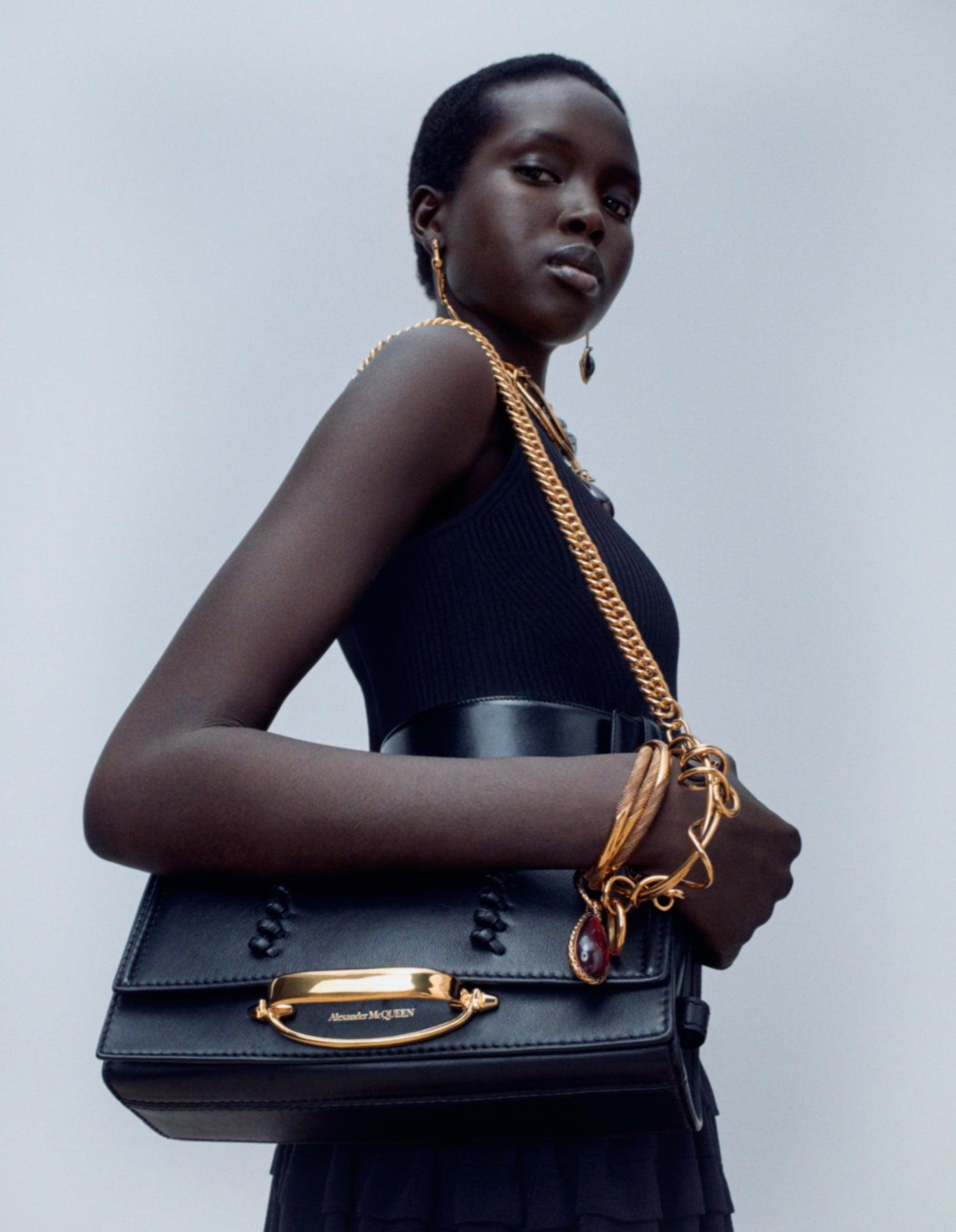 Model wears Alexander McQueen The Story shoulder bag