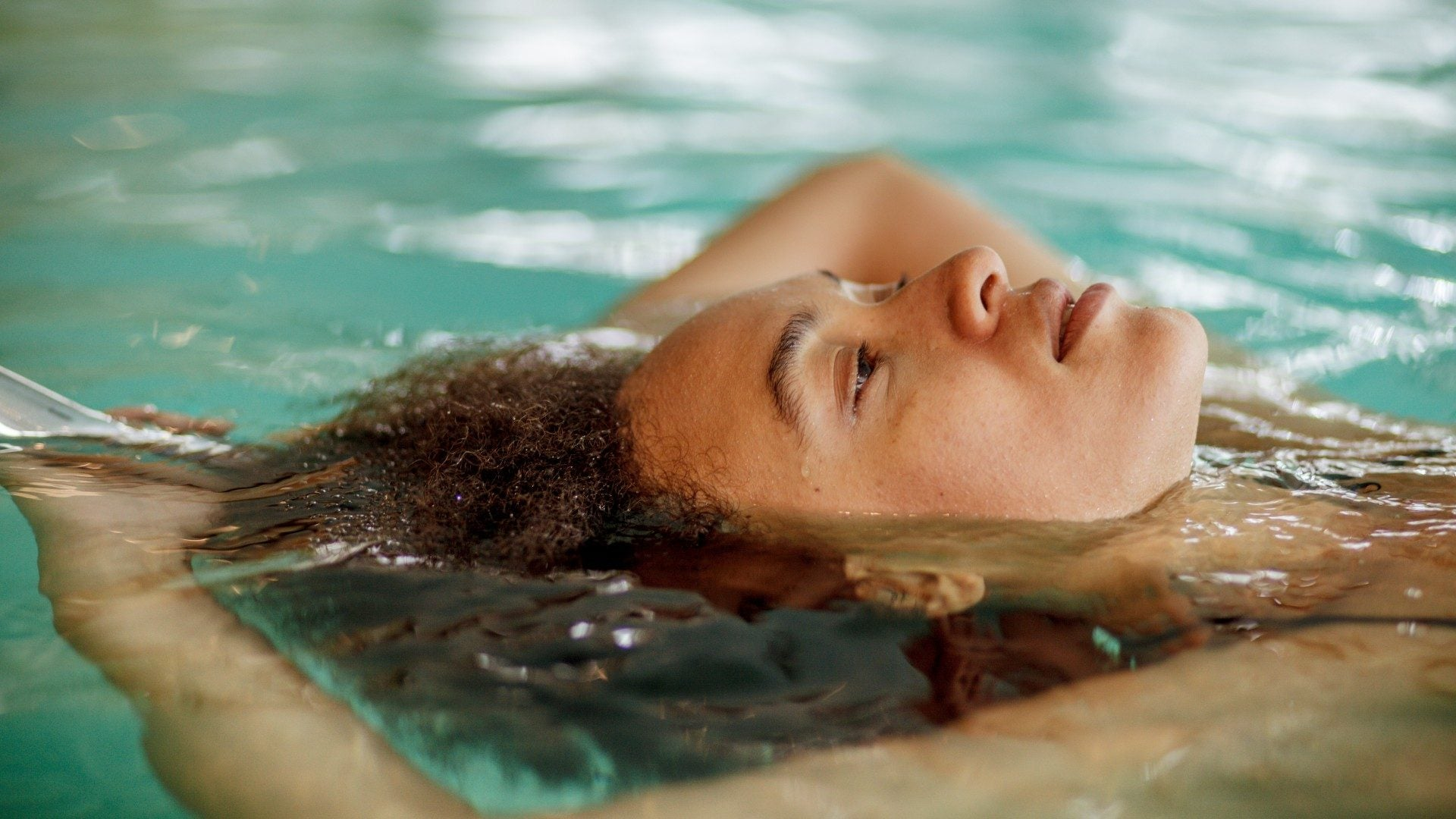 Olympic Swimmer Lia Neal Shares How To Care For Hair In And Out Of The Water