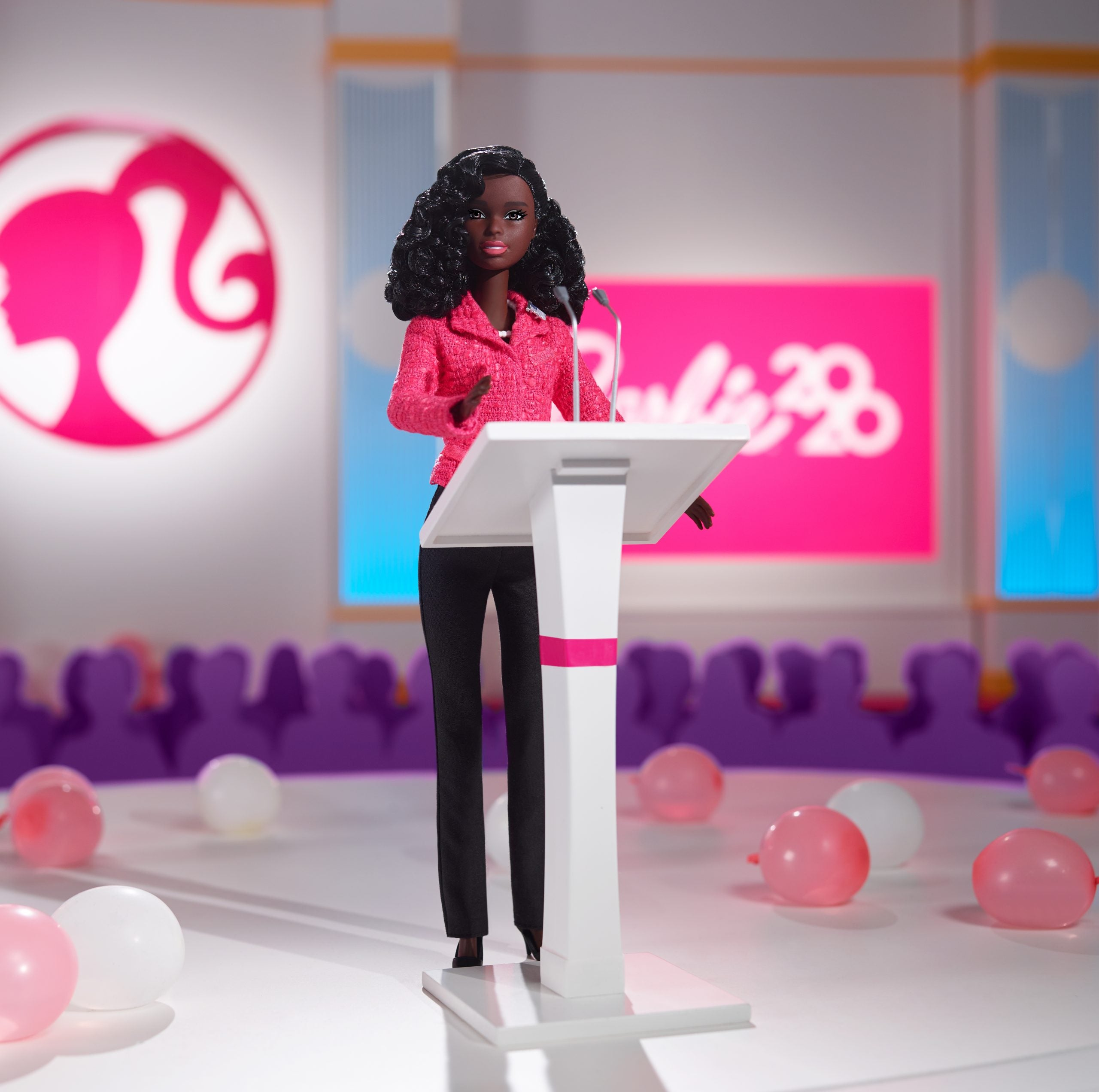 Black Barbie at podium