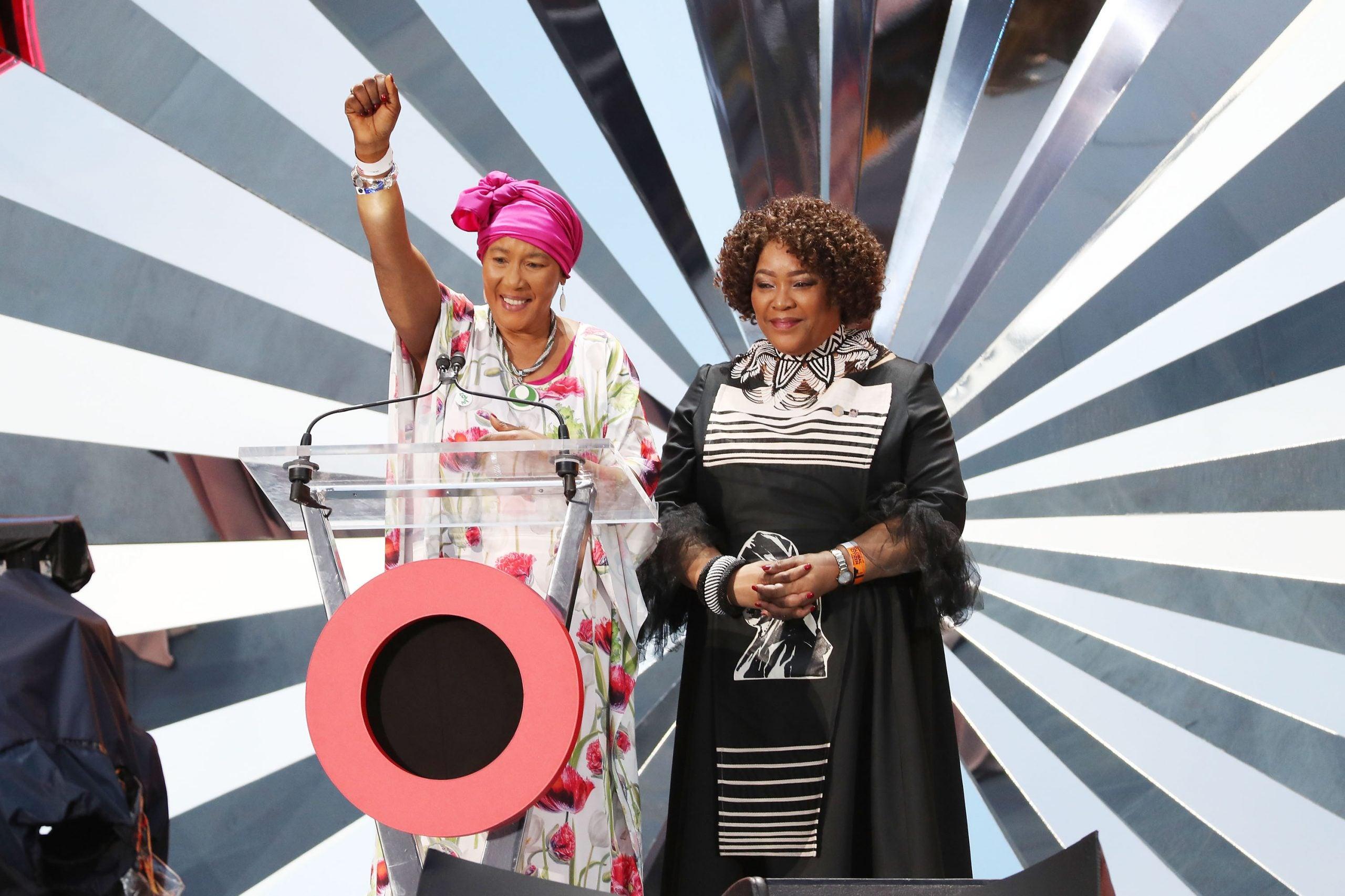 Zindzi Mandela and Makaziwe Mandela speak on stage.