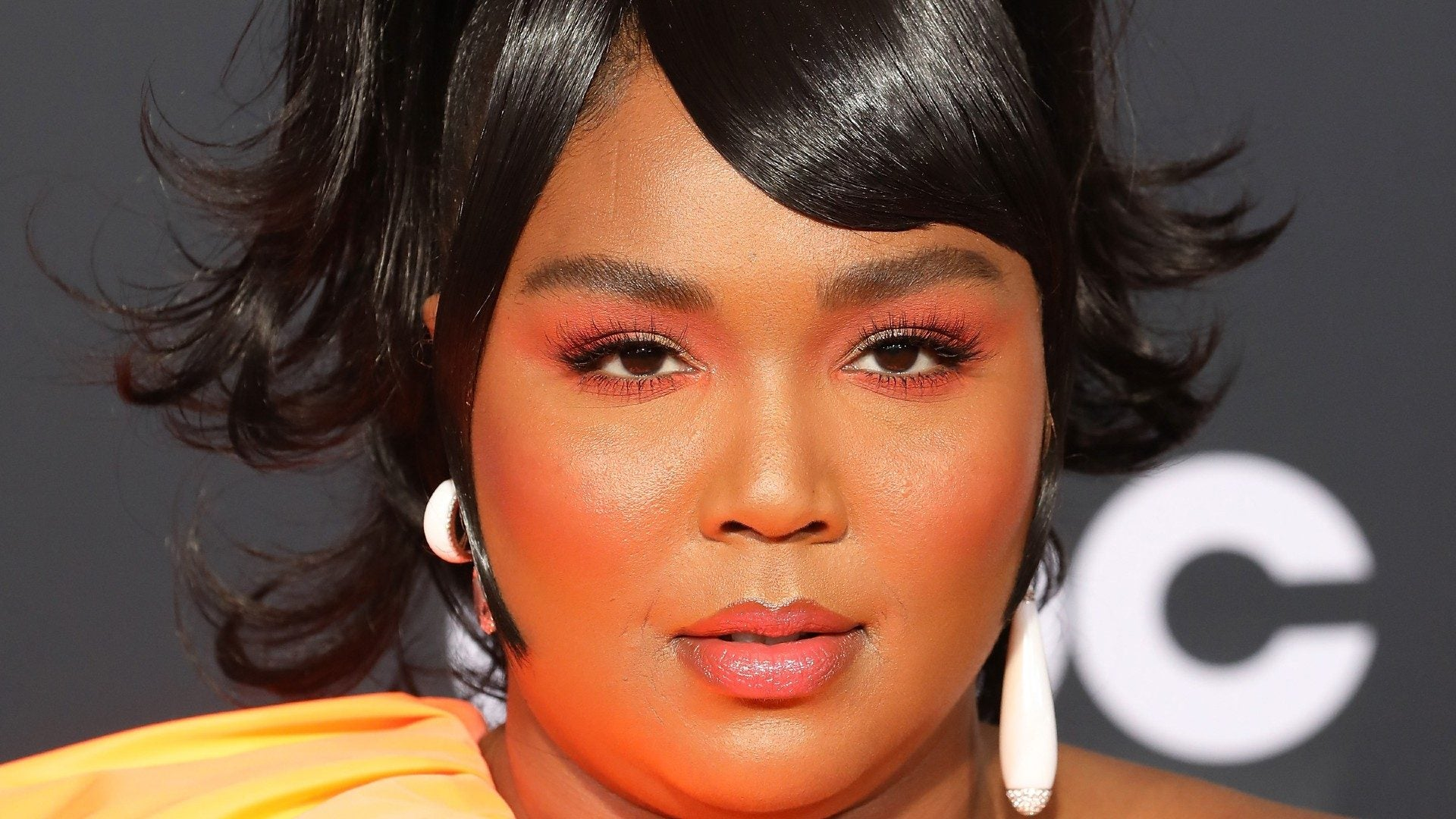 We Can't Get Enough Of Lizzo's  Money Green Hairdo