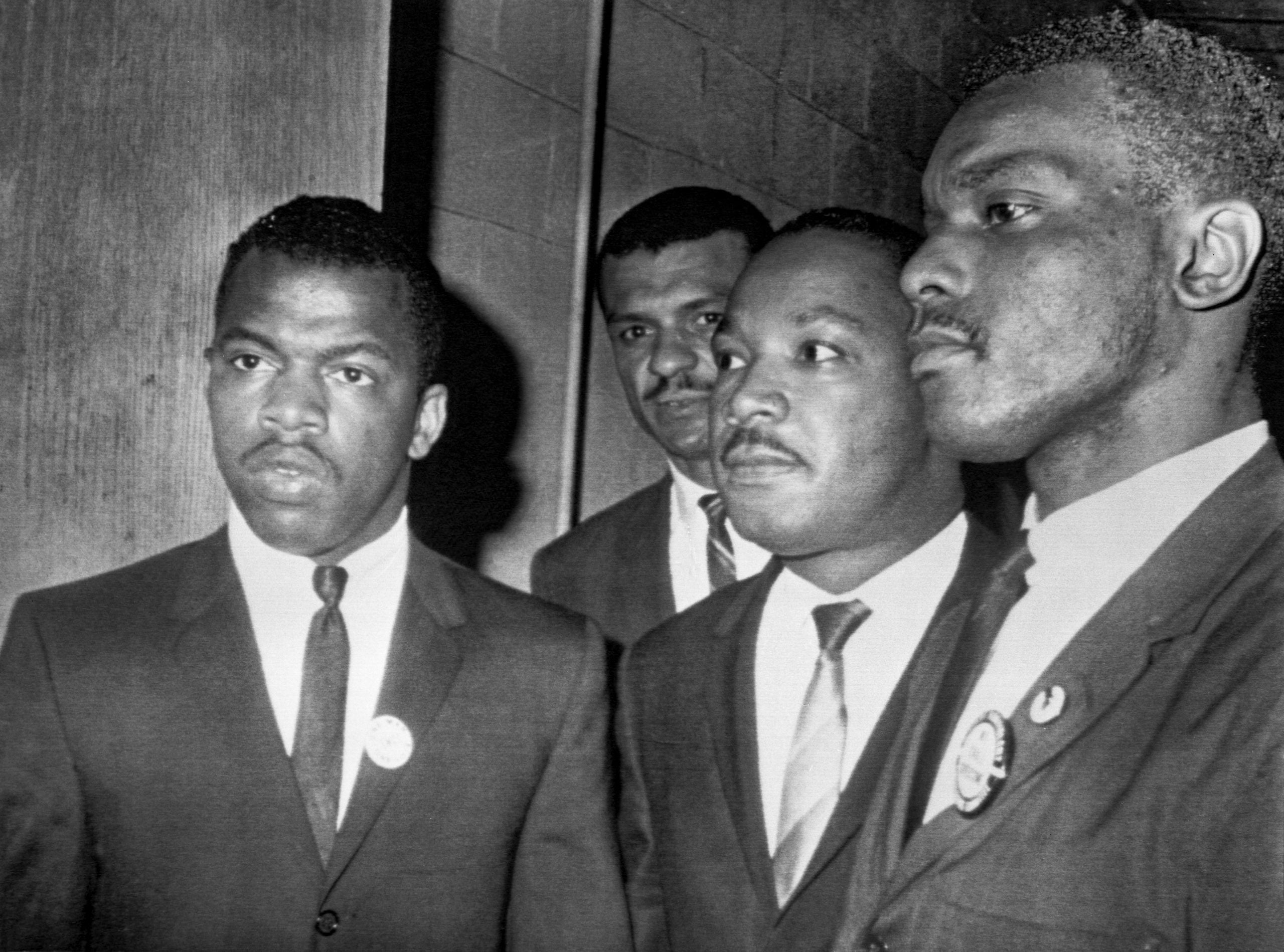Civil rights leader John Lewis with MLK. Lewis's body will lie in state at U.S. Capitol