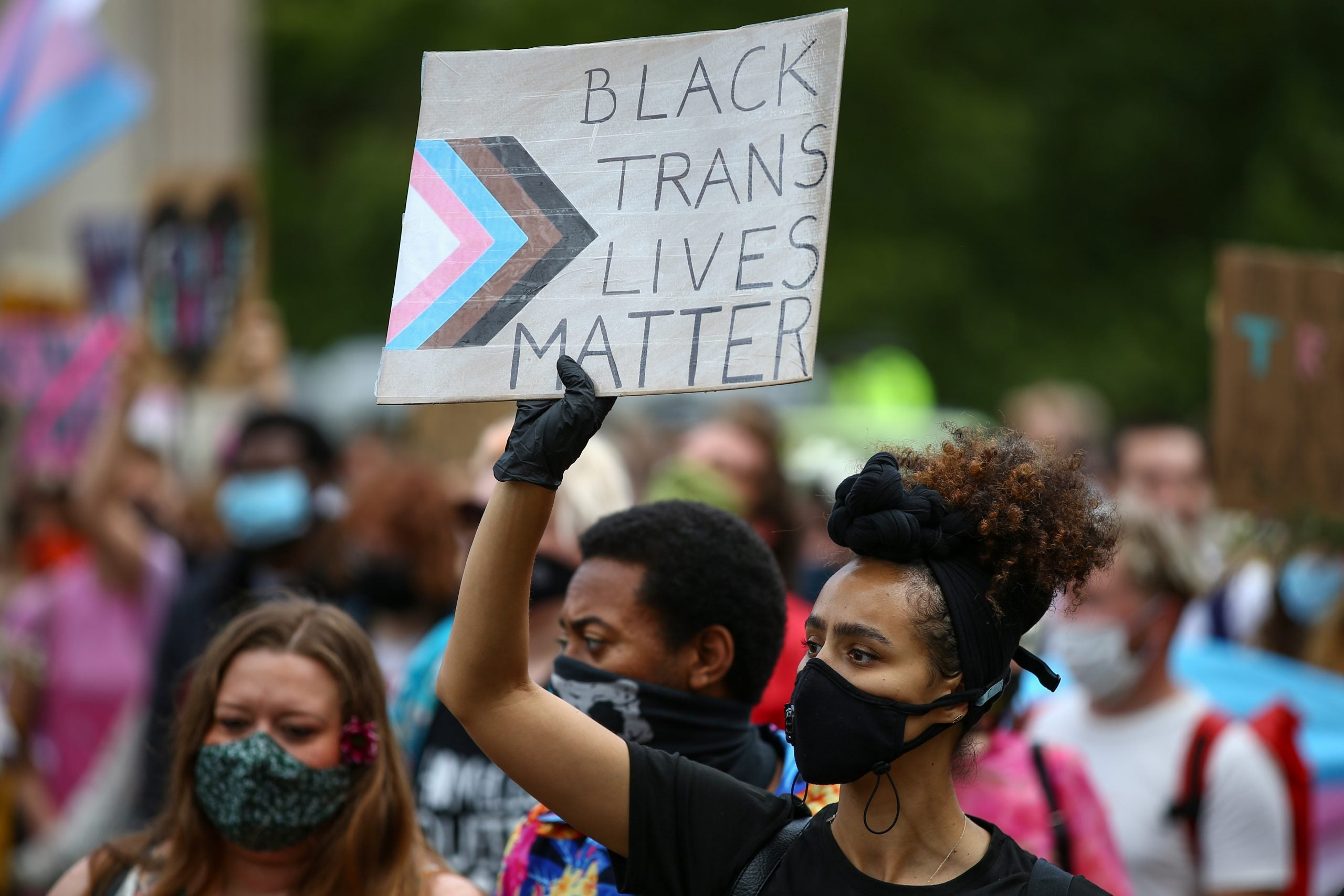 "Protesters in London hold a sign that reads ""Black Trans Lives Matter"""