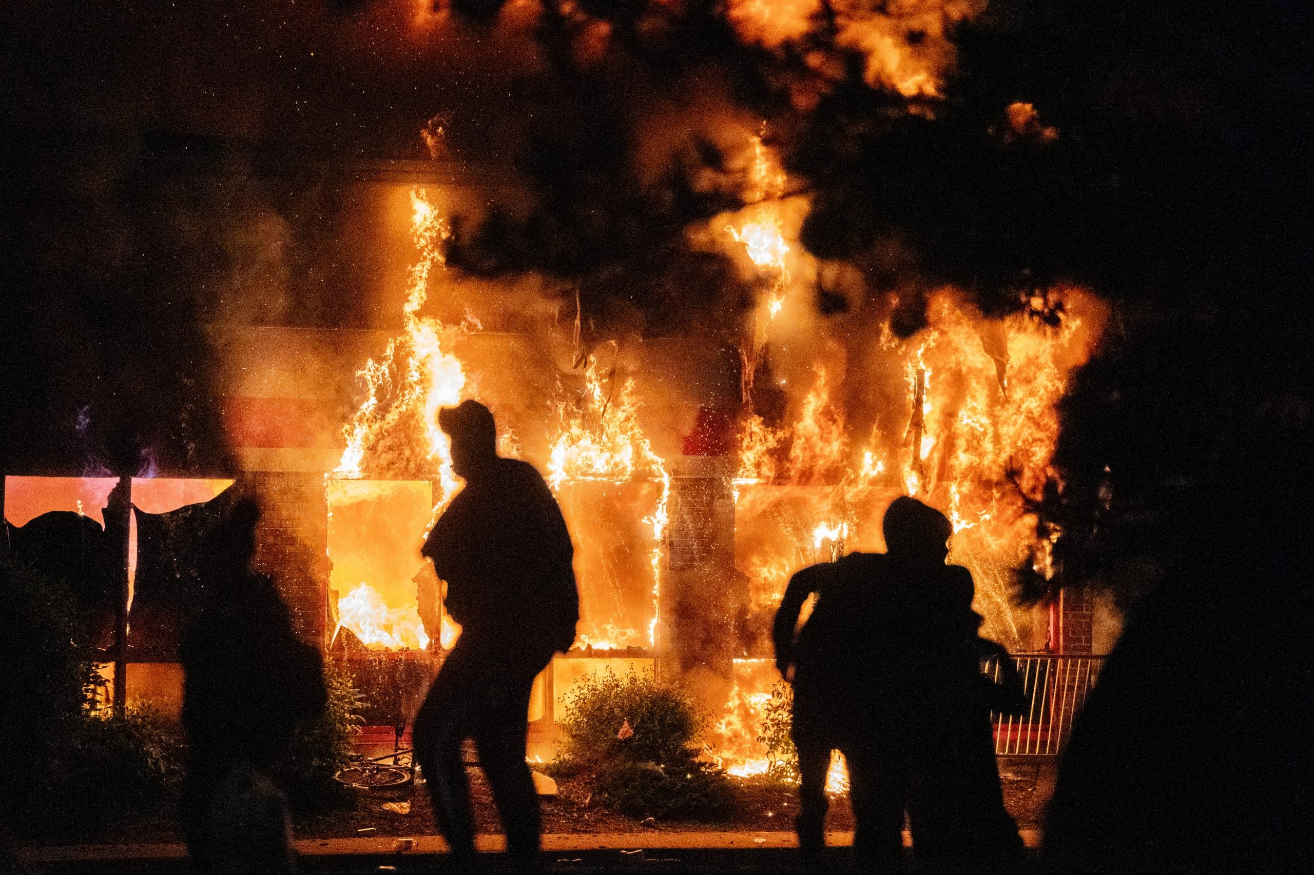 Minneapolis, MN May 27: AutoZone burned as protesters continued to gather outside of the Third Precinct. Protester and police clashed violently in South Minneapolis as looters attacked business on Lake Street on Thursday, May 28, 2020 in Minneapolis. The protests were sparked by the death of George Floyd at the hands of a Minneapolis Police officer Monday.(Photo by Mark Vancleave/Star Tribune via Getty Images)
