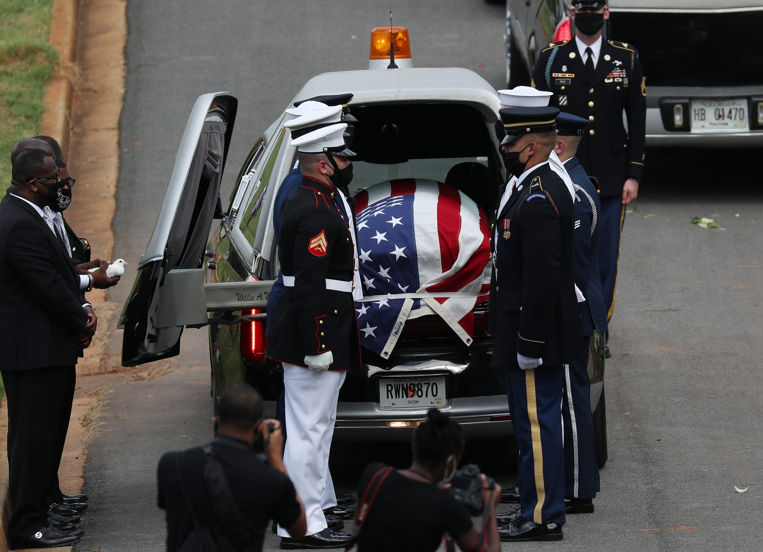 Members of the joint services military honor guard carry the casket of Rep. John Lewis (D-GA) during his funeral at the South-View Cemetery on July 30, 2020 in Atlanta, Georgia. Former U.S. President Barack Obama delivered the eulogy for the late Democratic congressman while former presidents George W. Bush and Bill Clinton also paid tribute. Rep. Lewis was a civil rights pioneer, contemporary of Dr. Martin Luther King, Jr. and helped to organize and address the historic March on Washington in August 1963.