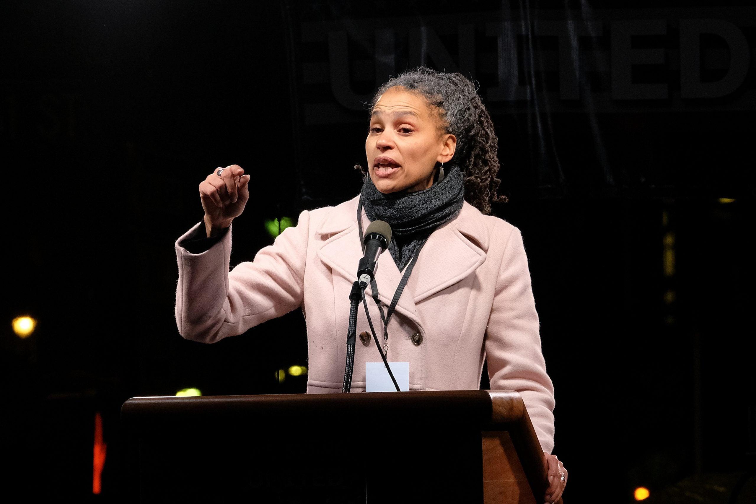 Maya Wiley stands at podium