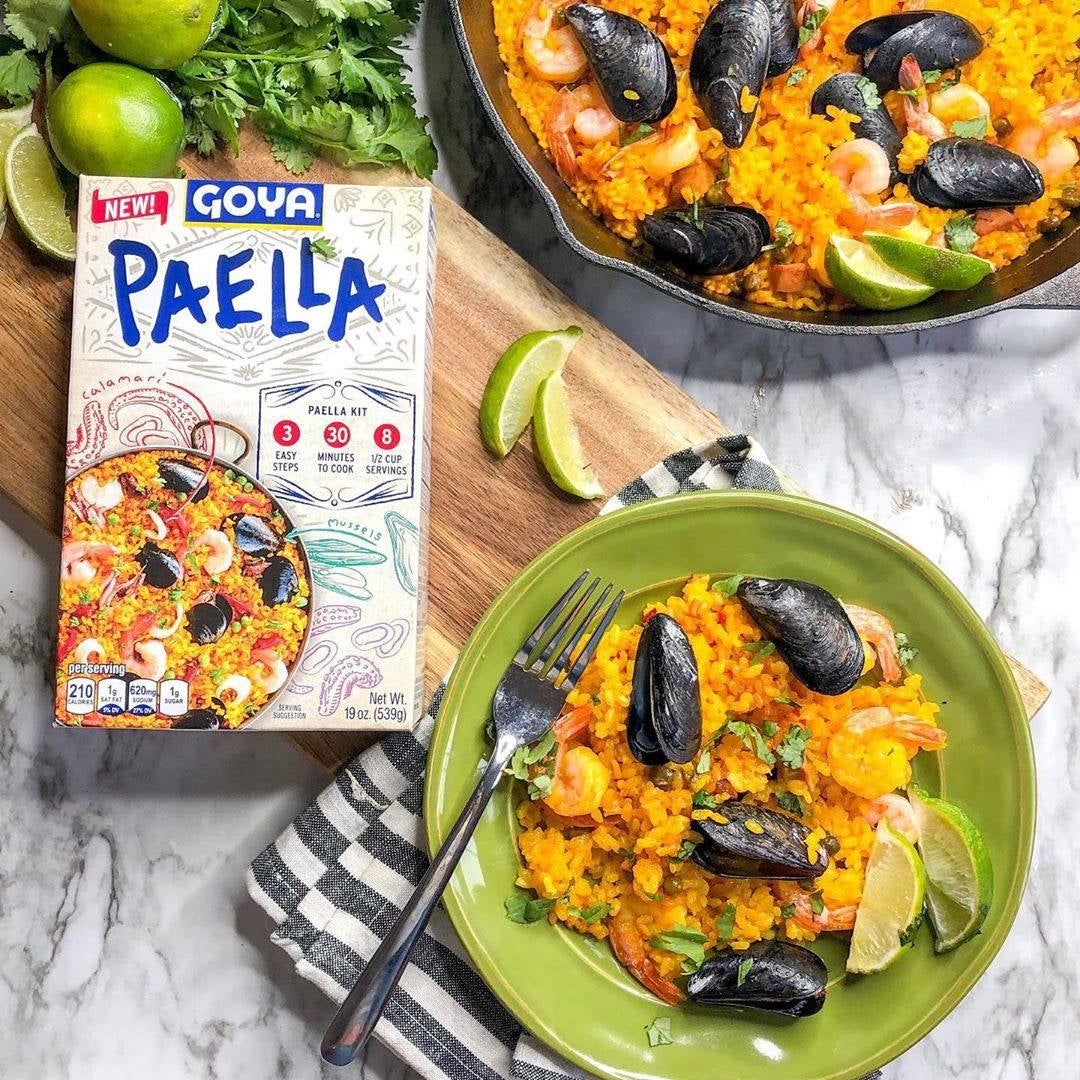 Goya paella kit photographed on plates with box packaging.