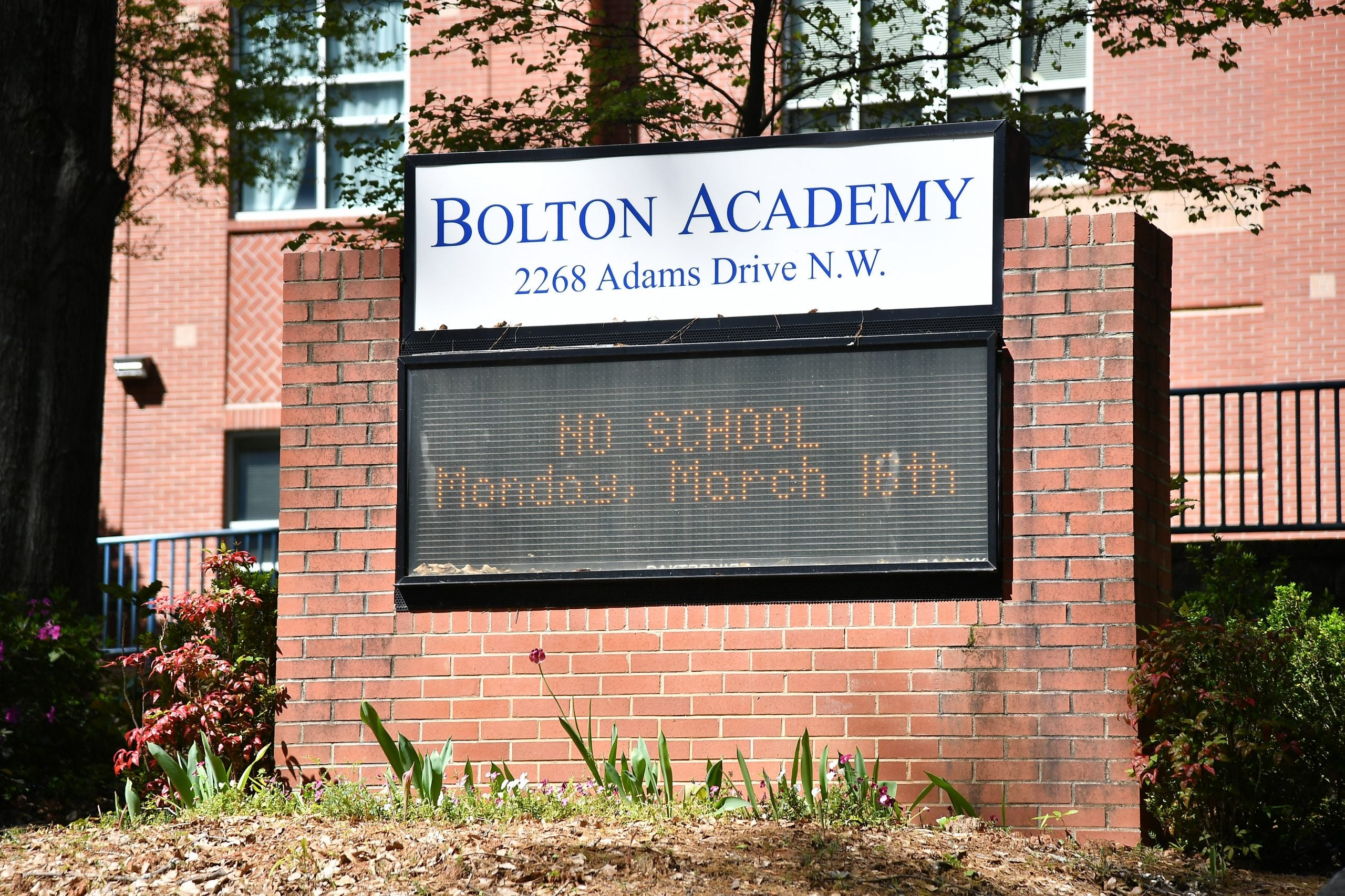 "Bolton Academy school building displays ""no school"" in digital billboard"