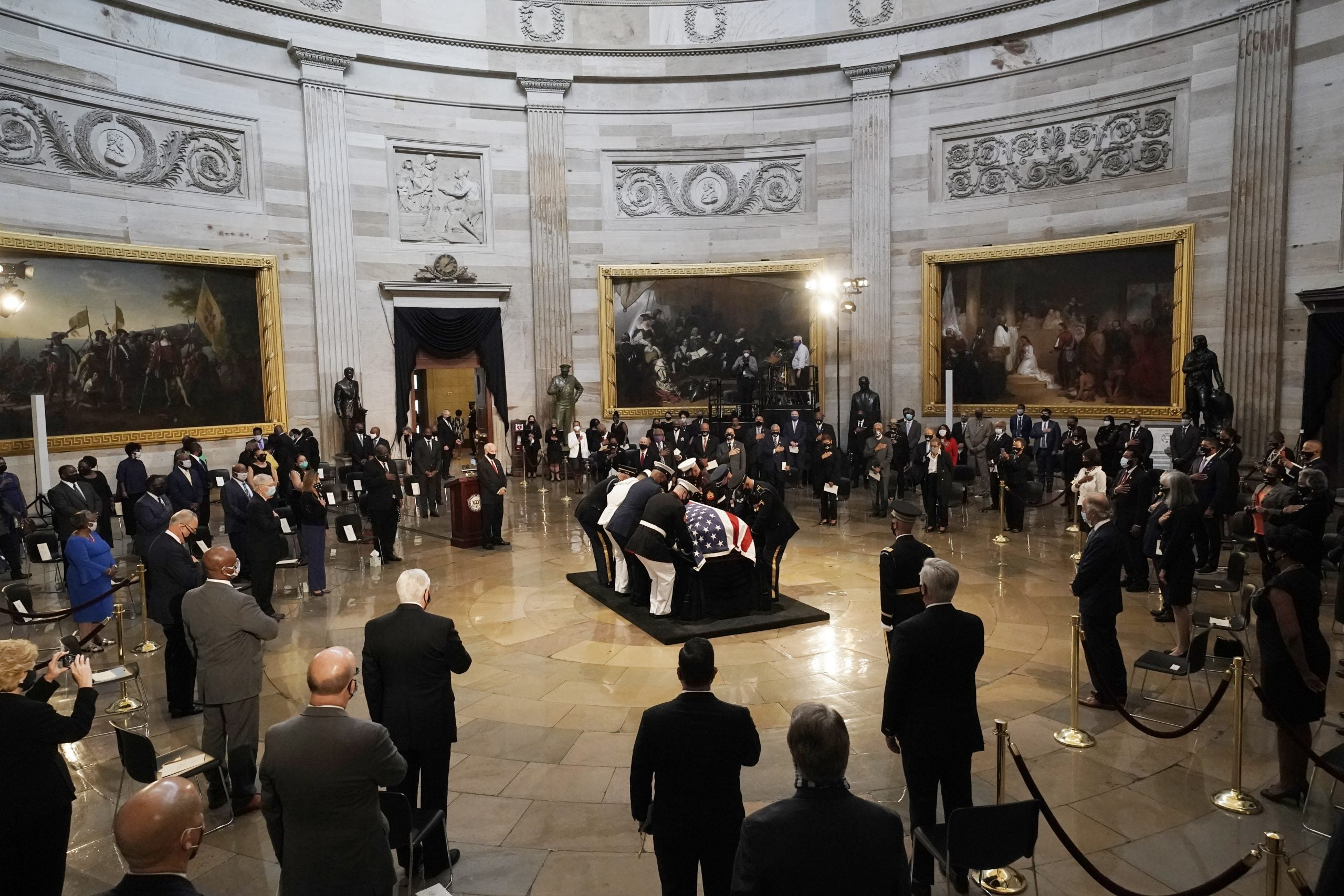 WASHINGTON, DC - JULY 27: The flag-draped casket of the late Rep. John Lewis (D-GA) is placed on the catafalque by a joint services military honor guard where it will lie is state in the Capitol Rotunda on July 27, 2020 in Washington, DC. Lewis, a civil rights icon and fierce advocate of voting rights for African Americans, will lie in state at the Capitol. Lewis died on July 17 at the age of 80. (Photo by J. Scott Applewhite - Pool/Getty Images)