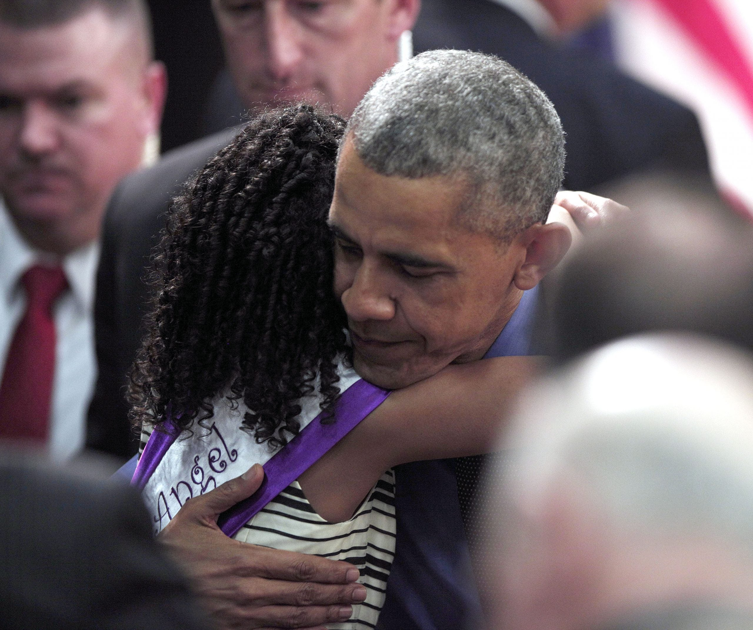 U.S. President Barack Obama hugs Maryanna Copeny of Flint, Michigan, age 8, after speaking at Northwest High School about the Flint water contamination crisis on May 4, 2016 in Flint, Michigan.