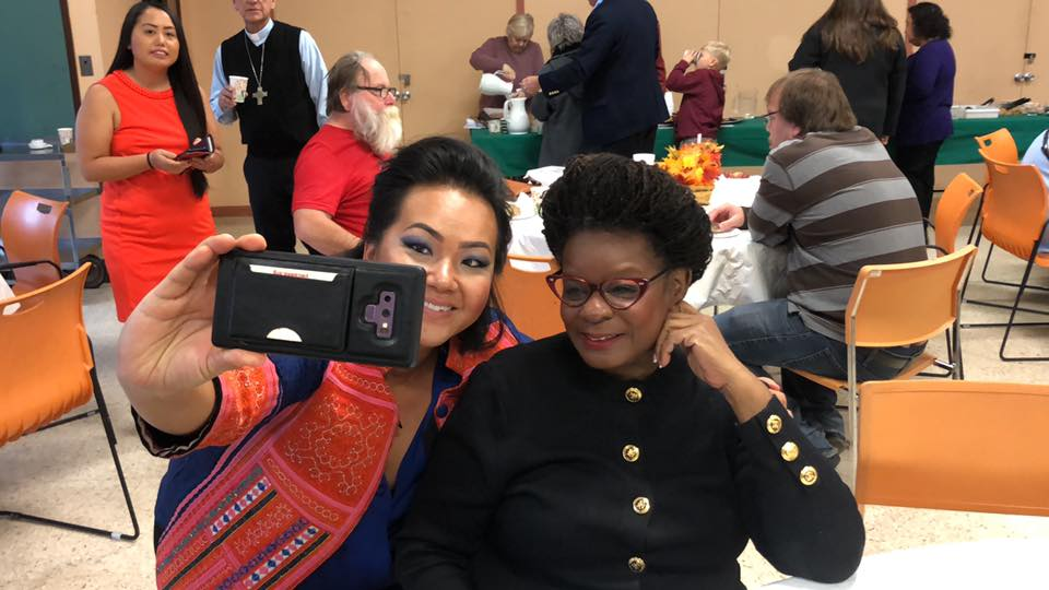 Gwen Moore poses with constituent in Milwaukee