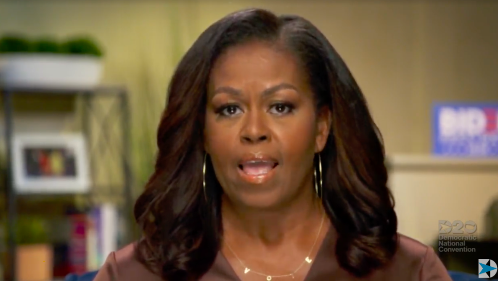 "Michelle Obama wears ""vote"" ByChari ""VOTE"" necklace"