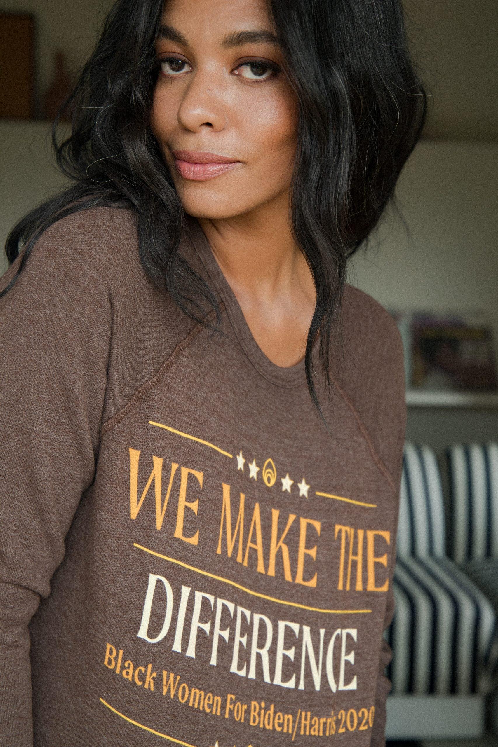 woman wears tee from Biden-Harris Believe In Better merchandise collection