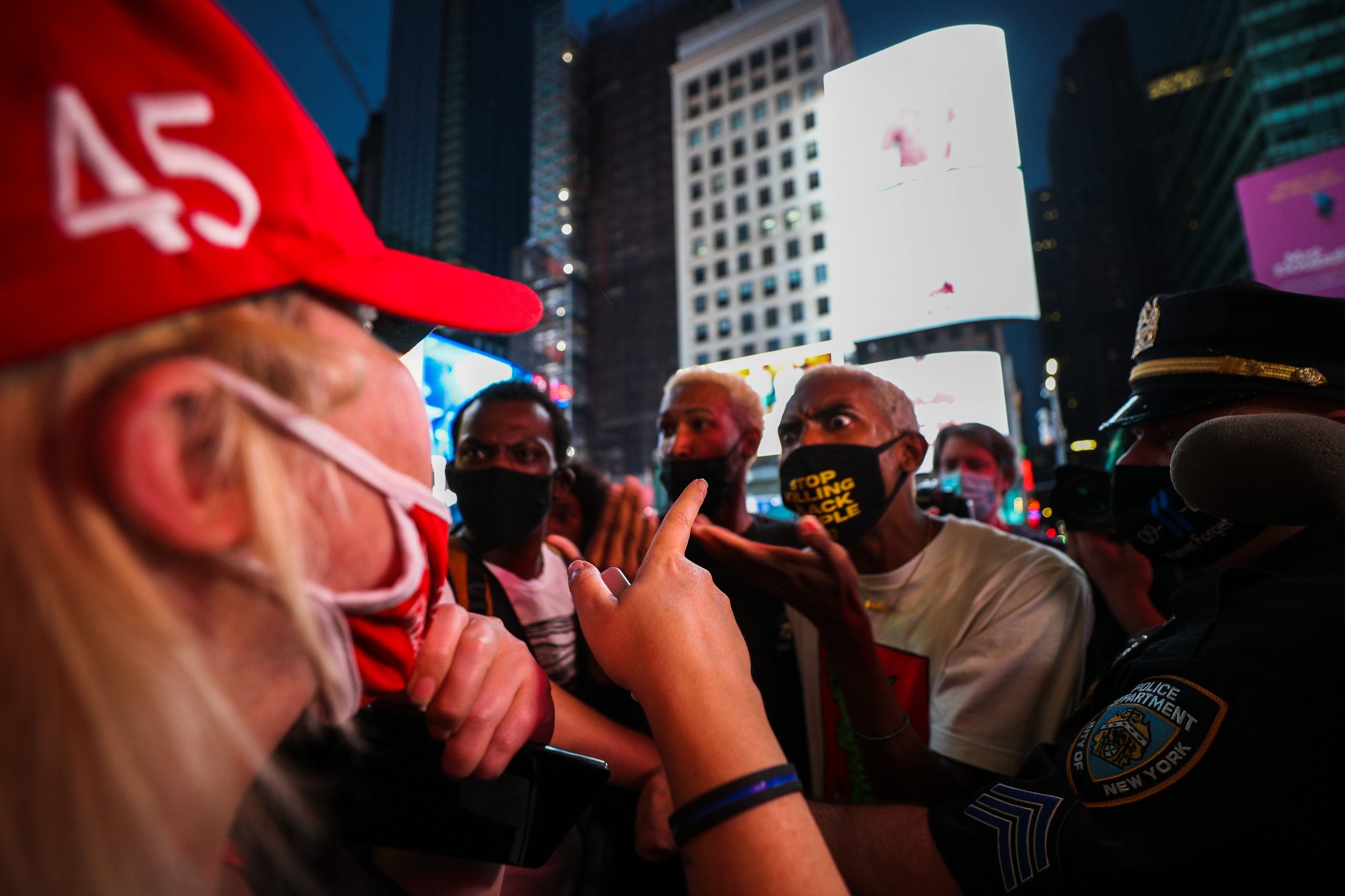 A group of protesters clash in Times Square