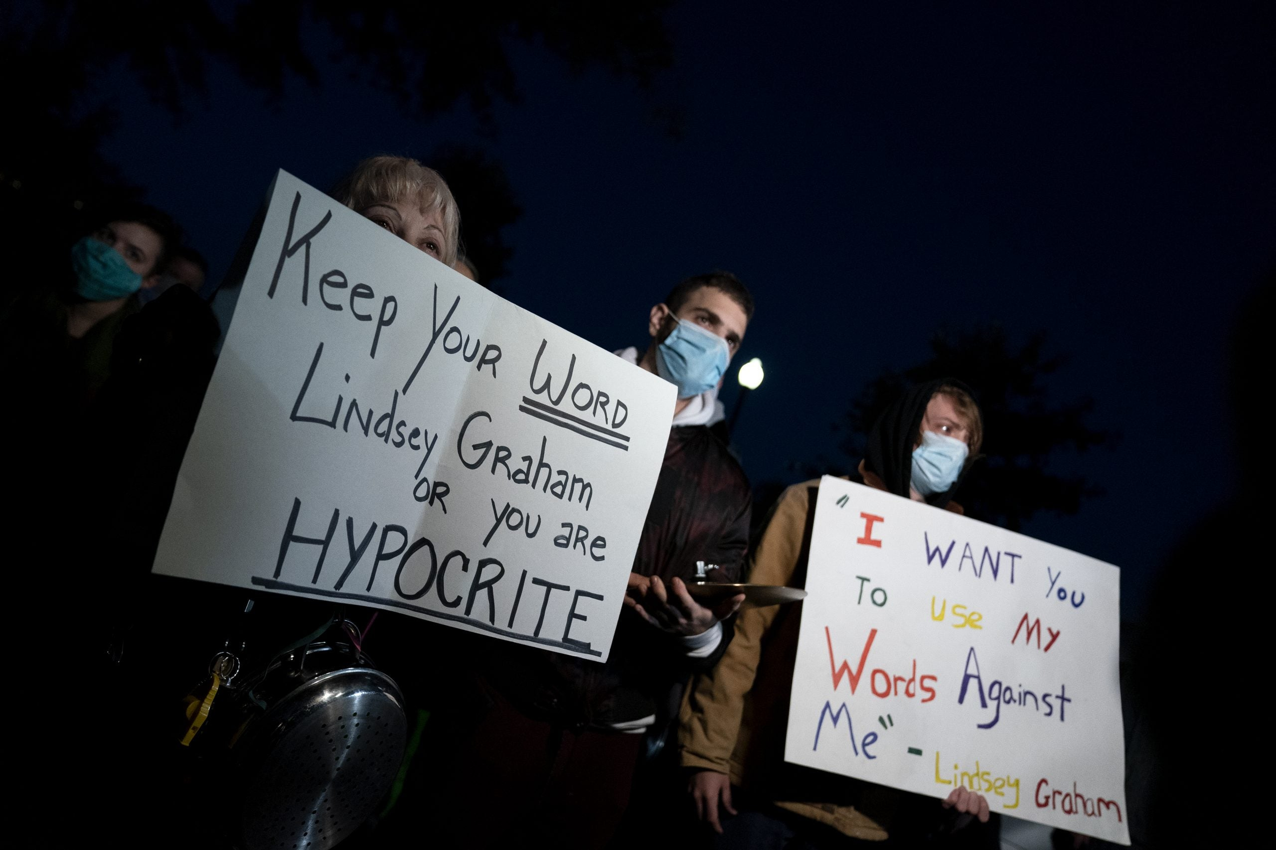 WASHINGTON, DC - SEPTEMBER 21: Protestors gather outside the residence of U.S. Sen. Lindsey Graham (R-SC) on September 21, 2020 in Washington, DC. Graham announced that he would support a vote on U.S. President Donald Trump's Supreme Court pick, after stating in 2016 that there should be no vote on a Supreme Court nominee during a Presidential election year. (Photo by Stefani Reynolds/Getty Images)