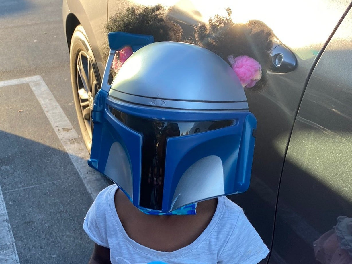 Let The Force Be With Her! Five-Year-Old Stunts In Star Wars Mask On Shopping Trip