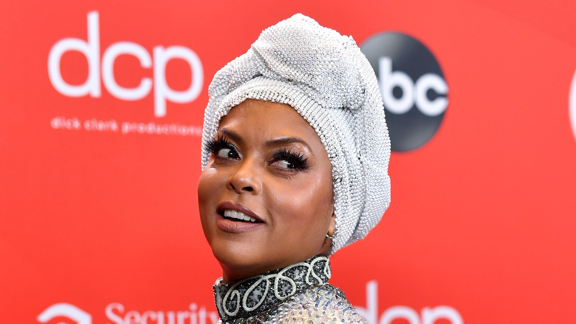 Taraji P. Henson's AMA Makeup Look Had To Complement A Whopping 10 Outfit Changes