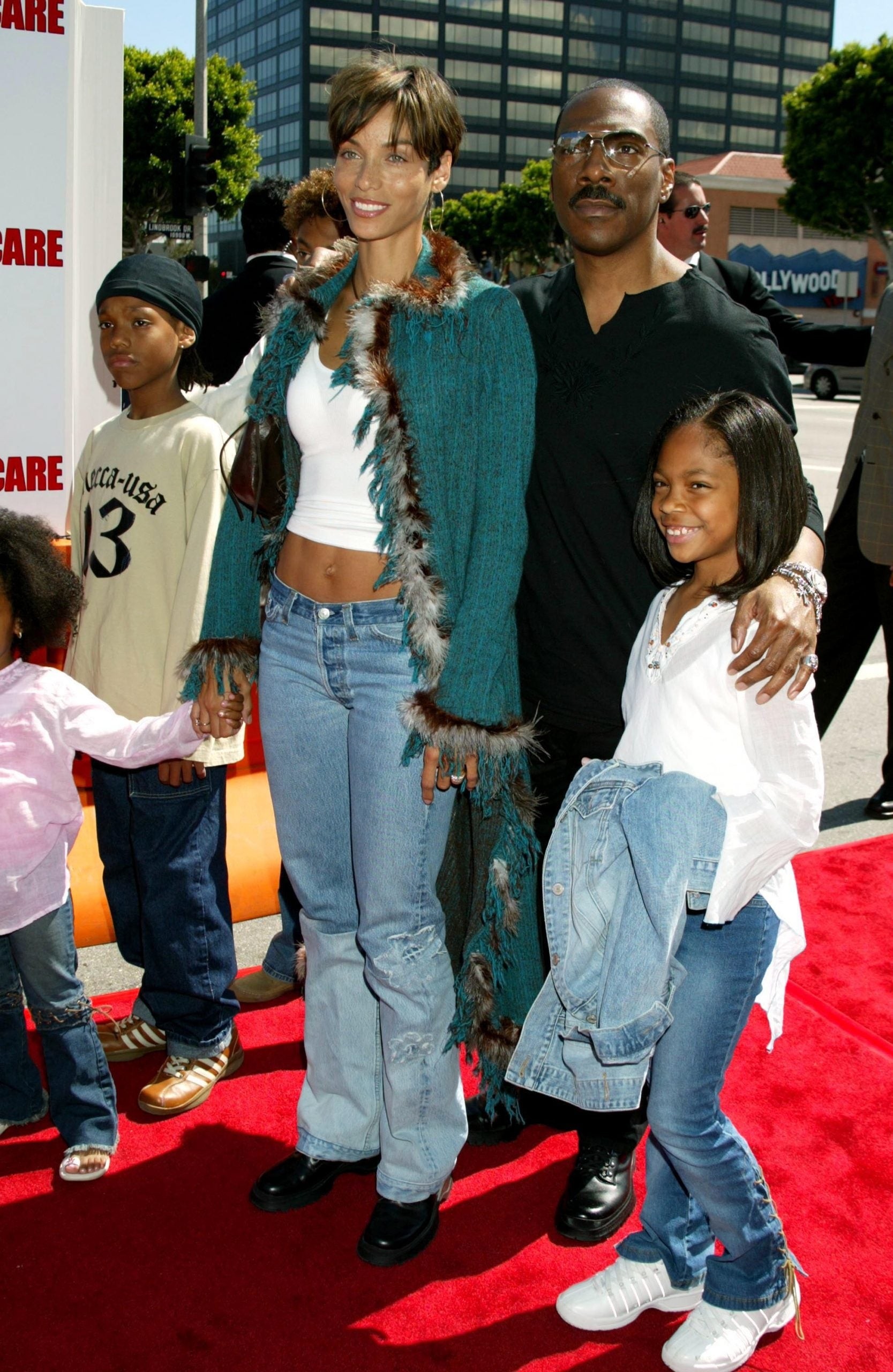 A Family Affair Eddie Murphy And His Kids Through The Years Essence He is shown holding izzy, 2, his daughter with butcher, while she cradles baby max. a family affair eddie murphy and his