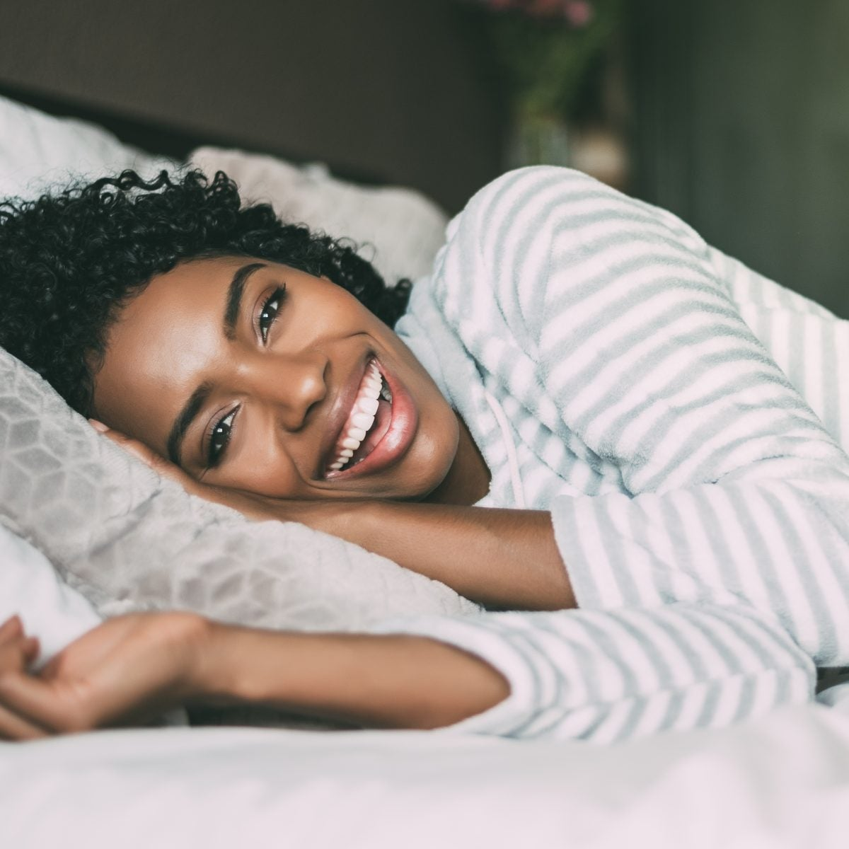 5 Ways To Prevent Hair Loss While You're Sleeping, According To Experts