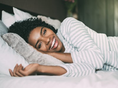 How To Prevent Hair Loss While You're Sleeping, According To Experts