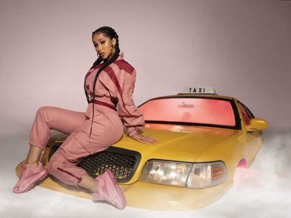 Cardi B Celebrates New Reebok Collection By Giving Back To The Kids At Her Childhood Elementary School