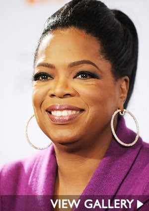 oprah-purple-shirt-smiling-view-gallery-300x425.jpg