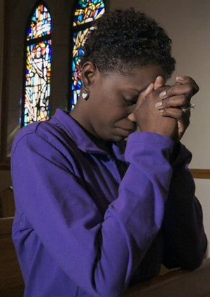 woman-praying-purple-shirt-425.jpg
